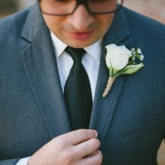 Brides.com: A Casual Nashville Wedding with a Rustic Theme. The groom's buttonhole boutonniere was made from white lisianthus and like the bride's bouquet was wrapped in jute twine.