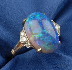 Crystal Opal and Diamond Ring, F & F Felger, Newark, c. 1940, the cabochon opal flanked by diamond melee, 14kt gold and palladium mount, size 4 3/4, maker's mark.