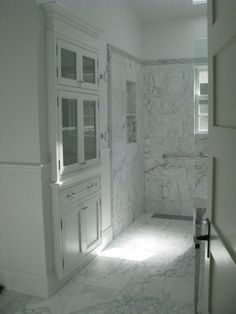Built-in bathroom linen cabinet by Wesley Ellen