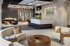 Midwest Commercial Interiors - Soelberg Industries: Ramo (White Finish) / Custom Reception Desk / Track Lighting / Suspended Ceiling