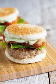 Club Burger Sliders with Avocado-Ranch Dressing - Slider sized turkey burgers are topped with bacon, lettuce, tomatoes and an avocado-ranch dressing. On Taste and Tell.