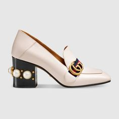 6dfe2d5386d6 Shop the Leather mid-heel loafer by Gucci. The Double G antique gold toned  hardware is set on a blue red Web of these mid-heel mules.