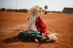 The frantic music and dancing transform the mask wearer into a spirit which communicates with ancestors.