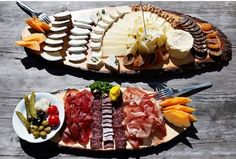 Cheese and Meat Platters- nice presentation...   I would add more fruit on the cheese plate or do a separate fruit tray to the side. Then it would be the perfect Trifecta ;)