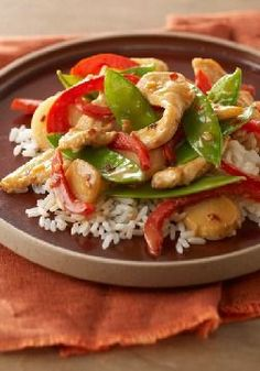 Firecracker Chicken Stir-Fry – Bright with red peppers and snow peas, this Firecracker Chicken Stir-Fry recipe is almost as good-looking as it is delicious!