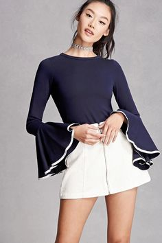 A stretch-knit top featuring long trumpet sleeves with contrast trim at the cuffs and a round neckline. This is an independent brand and not a Forever 21 branded item.