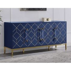 """Includes: One (1) Sideboard. Made of poplar wood with MDF, Lacquer and covered in High Gloss. Base is finished in gold made of stainless steal. Front panel has a geometric design with gold handles and acrylic handles. Both shelves are adjustable. Includes 1 pull out drawer for storage. Sideboard comes fully assembled. Contemporary and Glam Style. Fully Assembled Dimension 65""""L x 18""""D x 30""""H. All doors comes with hinges. Please note: Options of excessive weight or bulk will be shipped via Freight Modern Sideboard, Wood Sideboard, Countertop Materials, Wood Countertops, Wood Buffet, Adjustable Shelving, Living Spaces, Living Room, Modern Design"""