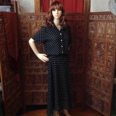 Retro beauty! 2 piece polka dot blouse & skirt Short sleeve collared polka dot blouse with iridescent mother of pearl buttons & matching long skirt which is fully lined with elastic waist. Brand is Graff, material is 100% polyester, size s/m, wrinkle free, can dress up or down, great for traveling Graff Skirts Skirt Sets