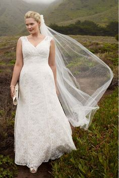 DB Woman at David's Bridal, Style 9T9612 (available in sizes 14-26)