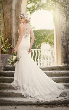 This designer fit-and-flare wedding dress from Essense of Australia is a perfect vintage-inspired look, filled with unique features. An illusion sweetheart neckline gives the bride a comfortable fit, while also allowing for the vintage lace detailing to extend beyond the neckline border in front.