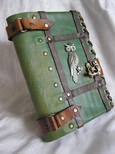 Handmade Leather Journal Notebook Owl Emblem  Omg eventually having something like this (with a wolf or fox or something) would be amazing