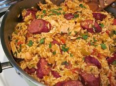 Easy Jambalaya - EASIER Jambalaya: use Zataran's Jambalaya mix, Andoulli Sausage, & deli-rotisserie chicken.  A family favorite & 30 minute 'go-to' recipe