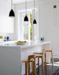 A modern kitchen with beautiful big windows Caravaggio, Alvar Aalto, Big Windows, Kitchen Lighting, Interior Architecture, Kitchen Dining, House Design, Table, Furniture