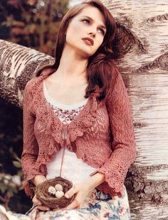 Lovely rose cropped cardigan (sadly, with no link!) Must run to Ravelry and find one.