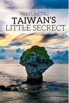 Iconic Vase Rock off Xiao Liuchiu Island, Taiwan. Xiao Liuchiu is a tiny island off the coast of Donggang, Taiwan.