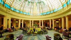Westin Palace Madrid -  La Cupula Lounge. Crowned with a magnificent Art Nouveau stained glass dome dating from 1912.