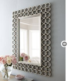 It's amazing how blank walls are transformed when almost anything is hung on them! They immediately burst to life. Mirrors are not only strong statement pieces, they also make a space feel bigger. Whether you have a light and airy room or a rugged and industrial space, this Silver Chain-Link mirror is perfect for filling the gap.