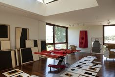 Studio space abounds on the property. The lot is zoned requiring that the two living units have a total of four parking spaces, and the garage can also be converted into an art studio. Call Art, The Outsiders, Two By Two, The Unit, Architecture, Artist, Table, Garage, Spaces
