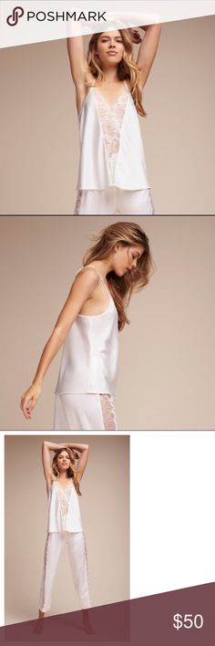 "BHLDN Flora Nikrooz White Bridal Simona Pajama Top New with tags. Size M. Purchased from BHLDN - Anthropologie's Bridal suite. Wake up in white! A sheer lace panel reveals just the right amount of skin while a loose silhouette brings comfort and ease. Matches the Simona Pajama Bottom.  A BHLDN exclusive Online exclusive By Flora Nikrooz Pull-on styling Polyester 24.5""L Hand wash Anthropologie Intimates & Sleepwear Pajamas"