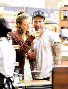 Behati Prinsloo Shows Adam Levine Her Phone, August 9, 2012