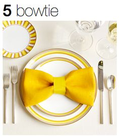 This bow tie napkin fold will add a fun pop to your table decor. Fold your napkin so the two halves meet in the middle. Fold it again, the same way as before, making a long strip. Fold the ends…Read more › Bow Tie Napkins, Cloth Napkins, Linen Napkins, How To Fold Napkins, Black Napkins, Place Settings, Table Settings, Wedding Decorations, Table Decorations
