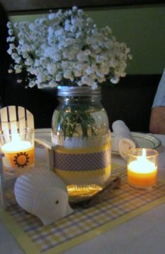 Rehearsal dinner at the beach decor: white, yellow, and gray