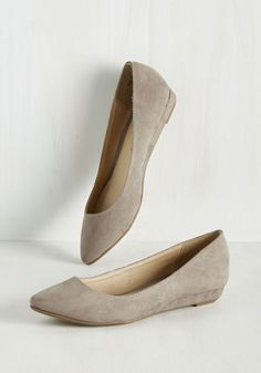 Before you prowl about town in these taupe wedges, you'd better make sure your entire ensemble shows off their classic beauty! Pointed at the toe and soft to the touch thanks to a faux-suede exterior, these low wedges are a fashionable and fab way to start your day.