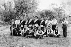 A group of men at a cricket game. They are, presumably, members of a lodge as all wear sashes and four also wear aprons.Place & Date Depicted:Victoria (?), Australia, circa 1905