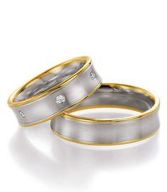 Weißgold Gelbgold Trauringe. Der Damenring mit Brillanten verziert, der Herrenring kommt eher einfach, sportlich daher.