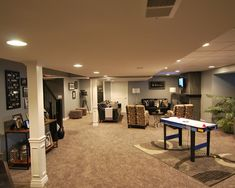 Basement media room with black ceiling BasementHome Office