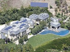 Palatial: The couple already own a $20million eco-friendly home in Brentwood, California (pictured) and are currently building a similar one...