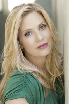Emily Procter. I love her personality on CSI Miami as Calleigh. Not always the best dressed, but smart and whitty and curvy instead of stick thin. Not to mention, the natural beauty. Very light looking make-up.