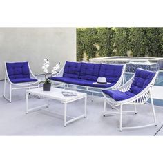This white Crick Indoor/Outdoor 4 Piece Aluminum Seating Group with Cushion is ideal for indoor or outdoor living and entertaining. The set includes a sling style sofa that sits up to 3 people, 2 sling chairs and a rectangular coffee table sporting a casual feel that is perfect for a deck, porch, patio or sun room. The sling chairs and sofa include solid blue fade resistant one-piece lace tufted cushions for added comfort and style. This Crick Indoor/Outdoor 4 Piece Aluminum Seating...