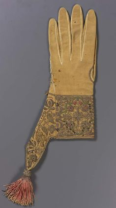 Glove   Museum of Fine Arts, BostonGlove  European 1600–50  Object Place: Europe  DIMENSIONS Overall: 53 x 18 x 2.5 cm (20 7/8 x 7 1/16 x 1 in.)  ACCESSION NUMBER 43.1974  MEDIUM OR TECHNIQUE Leather, embroidery