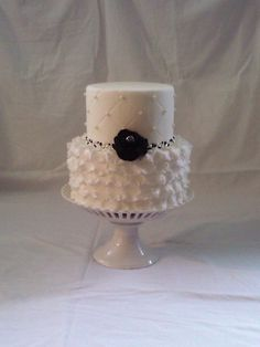 gorgeous white wedding cake with black and silver accents