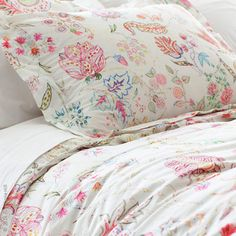 What's not to love about Pine Cone Hill's Mirabelle collection? A vintage Italian fabric served as the inspiration for this stunning printed cotton ensemble in shades of pink, red, blue, and green. In two sizes, the accompanying decorative pillow is enhanced with delicate embroidery.