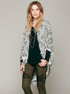 Free People Free People Ikat Hooded Poncho, $68.00 ........ sew the ends of a sarong together to form a tube, and leave small arm holes .... easy to DIY