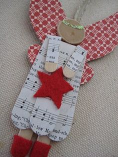 Close-up of red-winged popsicle stick angel. So cute.