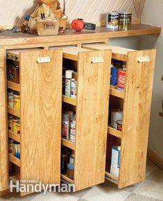 DIY: Workshop Rollouts - here's an awesome way to organize your garage! This tutorial shows how to make these space-saving shelves. Would be awesome in craft room! Workshop Storage, Tool Storage, Garage Storage, Storage Spaces, Diy Workshop, Storage Ideas, Diy Storage, Recycling Storage, Pantry Storage