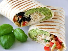 Grilled Mediterranean Couscous Wrap with Balsamic Glaze - Couscous, Avocado, Black Olives, Cherry Tomatoes, Red Pepper, Spring Onion, Fresh Basil and Toasted Pine Nuts with a side of Balsamic Glaze.