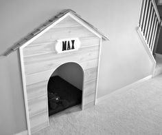 Built-in doggy nook underneath the stairs! Harry Potter meets cozy canine.