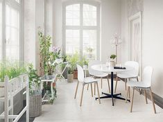 A-healthy-dose-of-greenery-for-the-all-white-Scandinavian-sunroom
