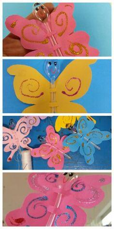 Piccole farfalle di carta e cucchiaini di plastica, per abbellire il soffitto della sezione