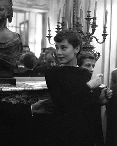 Audrey at a party in Paris photographed by Walter Carone