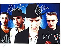 U2 Group Signed 8x10 Autograph Photo - Bono, The Edge, Larry Mullen, Jr. and Adam Clayton - Early Photo - Signed 8x10 Autograph Photo - Certificate of Authenticity Included - Authentic Hand-Signed Autograph