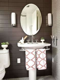 White porcelain, dark paint, and a subtle wall pattern.