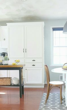 We're simply swooning over this dramatic kitchen and dining area transformation by Carli of @fwmadebycarli. With this before-and-after photoshoot, Carli walks us through over 10 years of changes resulting in a rustic farmhouse kitchen complete with sleek white cabinets, open shelving, and an industrial-style island painted with Black Boudoir. Her DIY projects are sure to inspire!