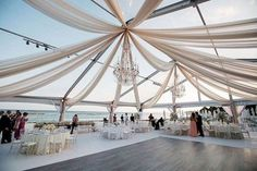 The Beach Tent -- Sand setting? Amazing! But unless you're going for the barefoot reception (which we're all for!) you may want to consider opting for a tent beach-side. Not only is the effect wispy and romantic, guests can keep their shoes on and you'll have to worry less about sand getting in the food. This version is just, perfect. We love the custom dance floor.