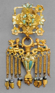"""Islam: Along with mosaics, Islamic culture can also be tied to having ornate, colorful jewelry often depicting religious symbols. """"Ear pendant with riders. Sirkap, Taxila, Khyber Pakhtunkhwa province 1st century CE. Gold and turquoise. H. 4 5/16 in. (10.9 cm)."""""""