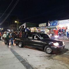 Getting around Panajachel Lake Atitlan Guatemala at night.  By Toyota pickup or Flete as they are called.  For about $.75 USD you can go from Pana to Solola.  Seeyouinguatemala.  #lakeatitlan #panajachel #guatemala #antiguaguatemala #lakes #lakeatitlantours #guatemalacity #flete #toyota #toyotatacoma #pickup #transport #bus  #nicaragua #elsalvador #honduras #panamacity #aussiesofinstagram #hostal #travelphotography